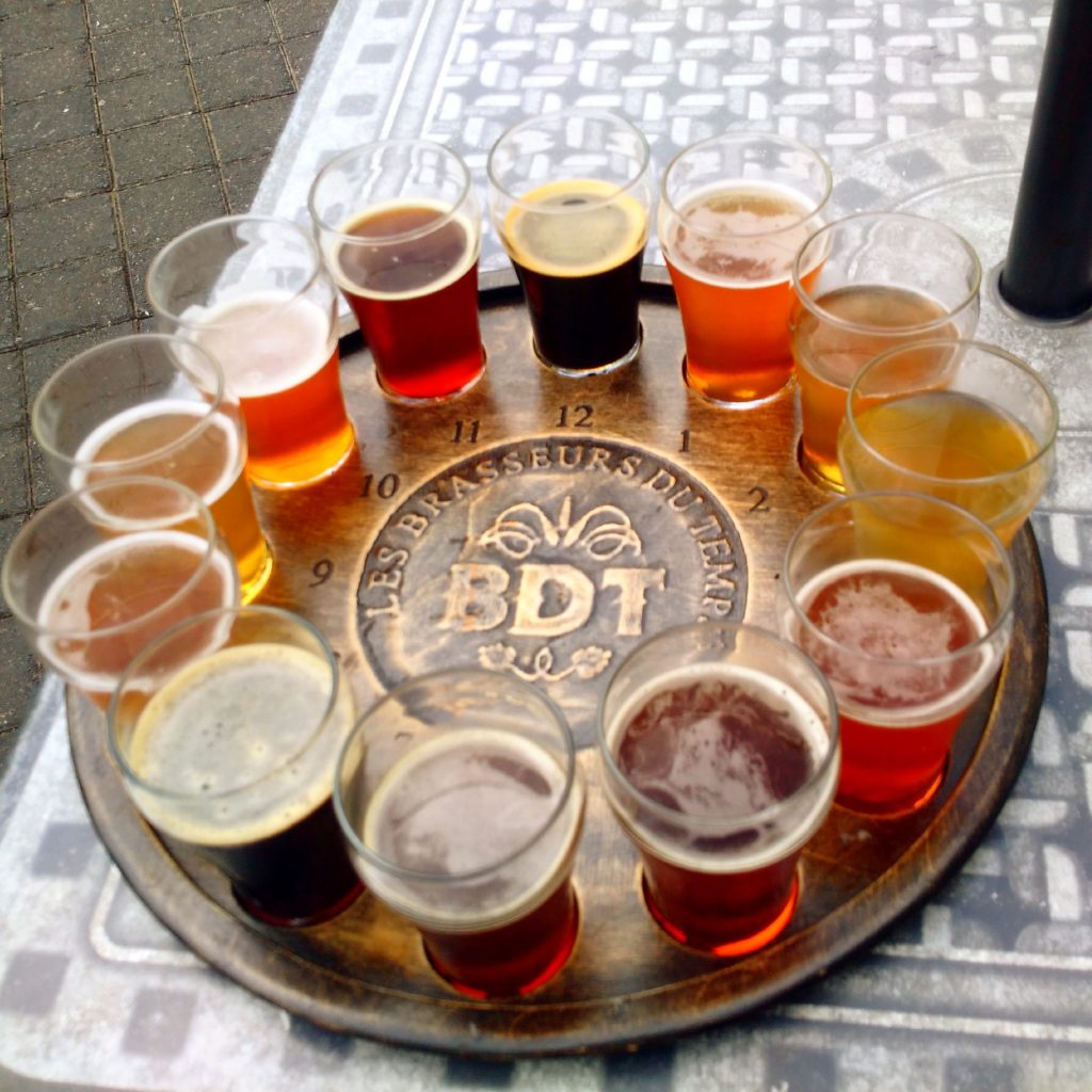 Beer sampler glasses on a round platter